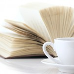 shutterstock_77718817-white-cup-of-coffee-and-open-book-on-white-background